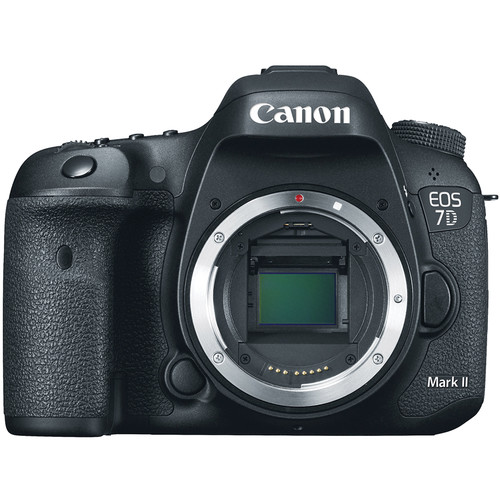 FOR_CANON Canon_7D_Mark_II_Body_EOS_DSLR_Camera When_Canon_has_presented_new_EOS_7D,_heated_debates_started_on_photographers`_forums._The_device_was_discussed_everywhere._Firstly_frame_format_caused_sort_of_confusion:_unlike_Canon_EOS_5D_Mark_II_which_was_presented_a_year_ago,_Canon_EOS_7D_has_an_APS-C_format_matrix._But_then_shutterbugs_and_advanced_photographers_understood_that_this_SLR_is_perfect_for_report_shooting._The_Canon_EOS_7D_Body_produced_for_shutterbugs_and_advanced_photographers._This_DSLR_camera_is_well-known_by_its_perfect_performance,_18_MP_resolution,_CMOS_sensor_and_high-end_dual_DIGIC_4_image_processors._You_can_easily_take_8_fps_high-resolution_images_with_minimum_noise_and_up_to_ISO_12800._Camera_is_bigger_than_its_predecessor_Canon_EOS_50D:_due_to_metal_housing_device_turned_out_quite_heavy,_but_at_the_same_time_perfectly_balanced.