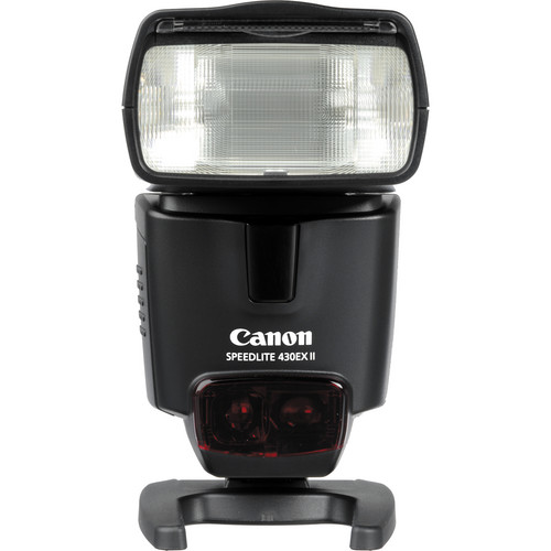 FOR_CANON Canon_Speedlite_430EX_II This_is_a_multi-purposed_powerful_circular_flash_that_expands_shooting_possibilities_thanks_to_guide_number_43,_9_custom_functions_and_range_of_automatic_increase_from_24_to_105_mm._Guide_number_of_43_makes_portable_and_compact_device_fantastically_powerful_for_shooting_at_reflected_work_with_general_telephoto_lens._When_being_used_with_compatible_cameras_with_E-TTL_II_metering_system_this_flash_provides_exact_rates_in_any_situation_even_if_light_is_reflected_from_walls_or_ceiling._You_can_set_flash_strength_manually_in_1/3_steps_for_total_control._Device_is_compatible_with_other_flashes_and_can_be_used_as_supplemental_one_ruled_by_main_flash._Due_to_its_unobtrusive_size_and_high_power_device_is_perfect_LED_flash_for_portable_studio_with_a_few_items._Metal_hot_shoe_and_special_mechanism_for_quick_connection_provide_reliable_and_convenient_mount_to_camera._Flash_covers_about_1-9_AF_points_and_has_inbuilt_source_of_infrared_radiation_that_provides_necessary_contrast_for_focusing.